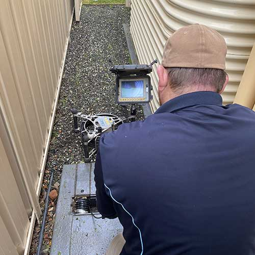 Plumber doing drain inspection