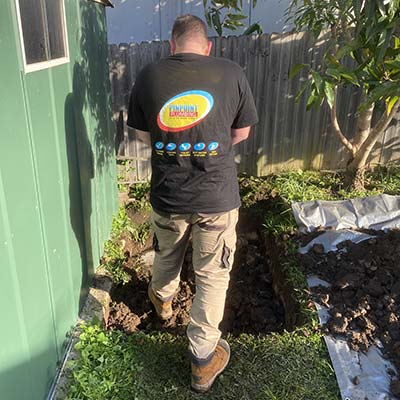 Plumber backyard drain inspection