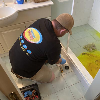 Plumber waterproofing bathroom shower